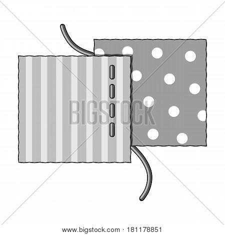 Different fabrics are sewn with thread.Sewing or tailoring tools kit single icon in monochrome style vector symbol stock web illustration.