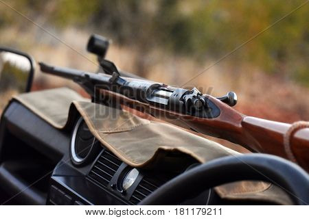 Picture of a rifle in a safari vehicle in South Africa.
