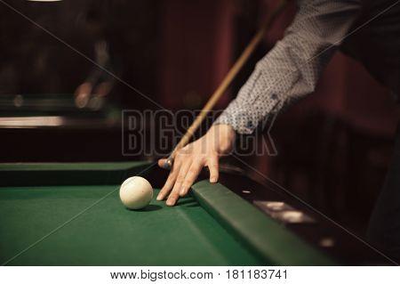 American billiard poule. Shot of a man playing billiard.