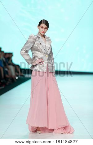 ZAGREB, CROATIA - APRIL 1, 2017: Fashion model wearing clothes designed by Luka Grubisic from the spring/summer collection at the 'Fashion.hr' fashion show