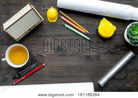 architect office with tools and cup in profession concept on wooden desk background top view mock-up