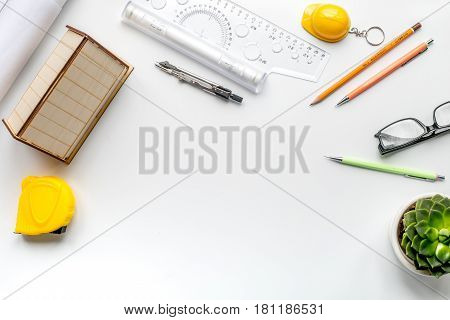 architect working desk with flower, pens and ruler on white background top view mock up
