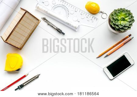 architect office with tools and phone in profession concept on white desk background top view mock up