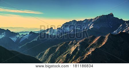 Alpi Apuane mountains and marble quarry view at sunset. Carrara Tuscany Italy Europe.