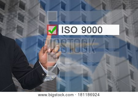 Hand Of Businessman Use Finger Touch To Button To Select In Text Box Of Iso 9000 Concept Of Presenta