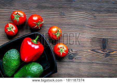 Store concept with vegetables and plastic tray on wooden table background top view mockup
