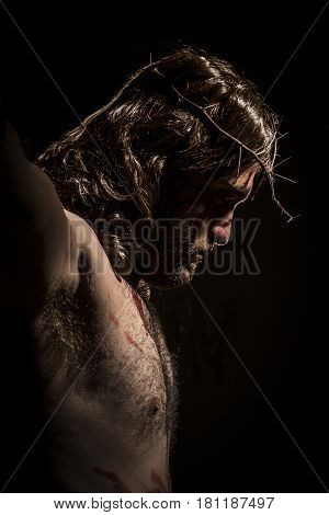 Jesus Christ crucified with crown of thorns during the passion