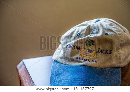 HAMILTON BERMUDA - AUGUST 11 2014: Closeup of hat from Onion Jack's in Bermuda in warm tones with copy space