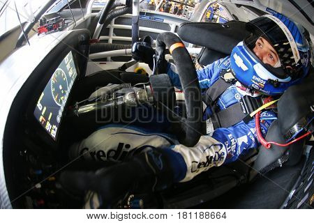 April 08, 2017 - Ft. Worth, Texas, USA: Kyle Larson (42) straps into his Chevrolet race car before the O'Reilly Auto Parts 500 at Texas Motor Speedway in Ft. Worth, Texas.