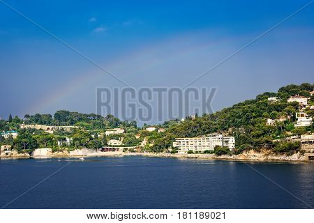 Coastline of Nice France with raibow in the sky