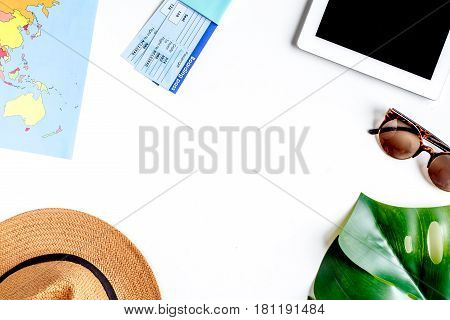 journey planning with tourist outfit and tablet on white table background top view mockup