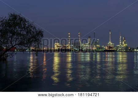 Refinery tower in petrochemical industrial plant with river
