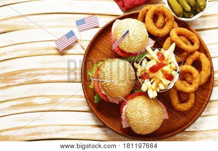 Burger, french fries and onion rings food for the celebration of July 4