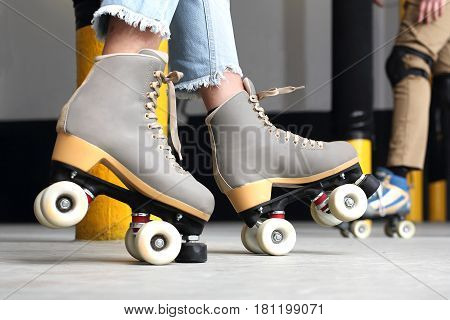Woman on roller skates. Rollerskating Learn to ride on roller skates Young woman  riding on roller skates
