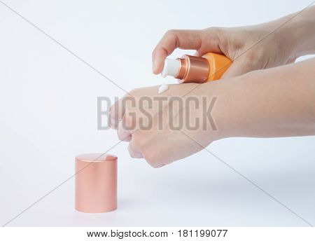 Woman hand holding cosmetic bottle isolated on white background, stock photo