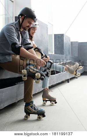 Roller skates. Woman on roller skates. Rollerskating Helmet, head protection. Young people riding on roller skates Pads and knee pads