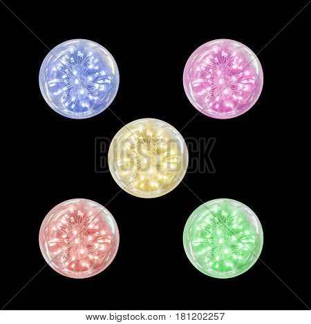 Closeup group of opening light bulb with blue pink green red and yellow light isolated on black background