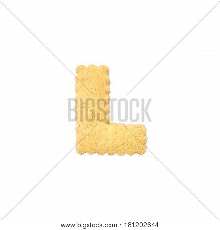 Closeup brown cookie in L english alphabet isolated on white background with clipping path