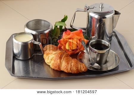 Romantic breakfast in bed. Coffee set, rose, crisp with egg on a silver tray. Healthy concept. Love. Romance