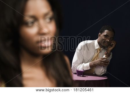 African man looking at woman