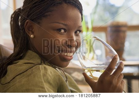 African woman drinking wine