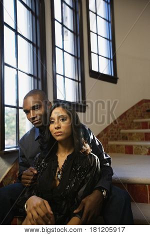 Multi-ethnic couple sitting on stairs