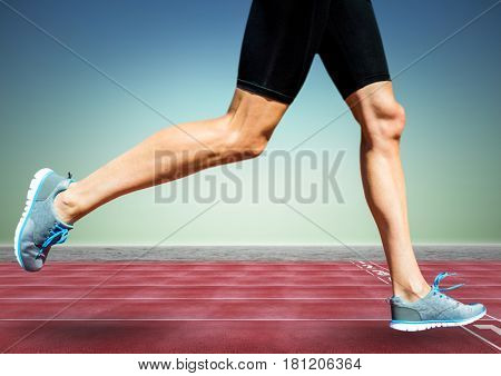 Digital composite of Runner legs on track against blue green background