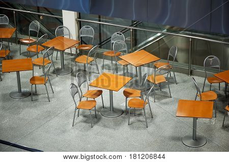 food court interior with tables and chairs view from above