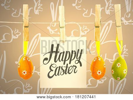 Digital composite of Happy Easter text with Easter Eggs on pegs with note in front of pattern