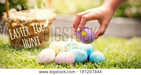 Little girl collecting easter eggs against easter egg hunt logo against white background