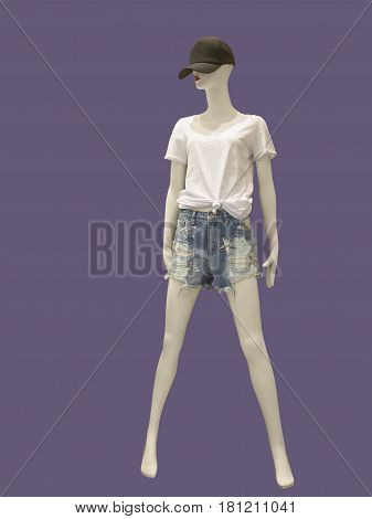 Full-length female mannequin dressed in shorts and t-shirt. No brand names or copyright objects.