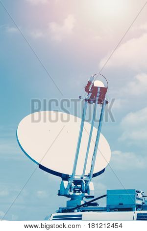 Satellite dish mounted mobile vehicle hi-tech communication.