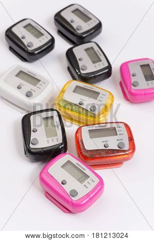 Colorful Pedometers Over White Background