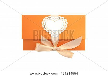 Orange gift envelope tied with a pink ribbon on a white background