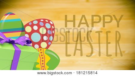 Digital composite of Green type and green gift and red green eggs against green background