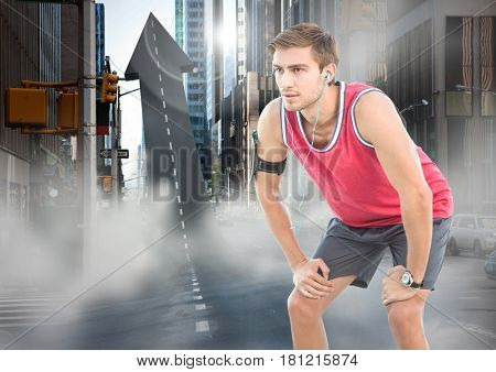 Digital composite of Male runner with headphones on arrow shaped road in street