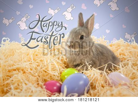 Digital composite of Happy Easter text with Easter rabbit in front of pattern