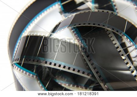 old 8mm cine film and reel  isolated on white