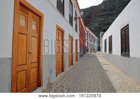 AGULO, LA GOMERA, SPAIN: Cobbled street with colorful houses inside the village of Agulo
