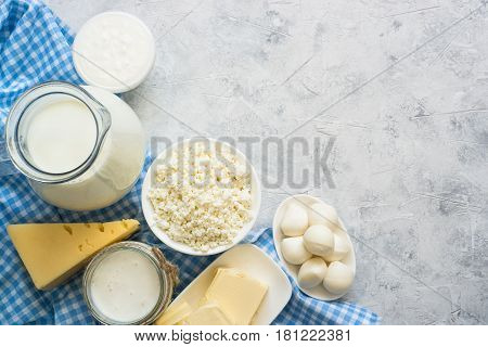 Selection of Dairy products. Cottage cheese or curd, yogurt, Sour cream, milk and mozzarella concrete table.