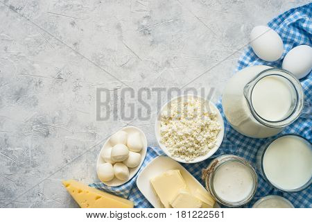 Selection of Dairy products. Cottage cheese or curd, yogurt, Sour cream, milk butter and mozzarella at concrete table. Top view