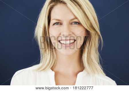 Happy Blue eyed babe in studio portrait