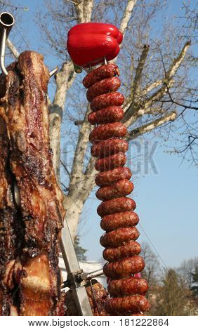 Skewer With Red Peppers And Pork Sausages On A Spit In The Stree