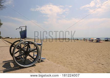 Special Wheelchair With Big Steel Wheels To Cross The Sandy Beac