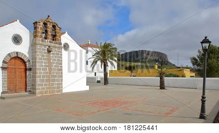 CHIPUDE, LA GOMERA, SPAIN: The church of Chipude (la Iglesia de la Virgen de la Candelaria) with Fortaleza mountain in the background