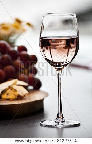 glass of wine with cheese and reflactions