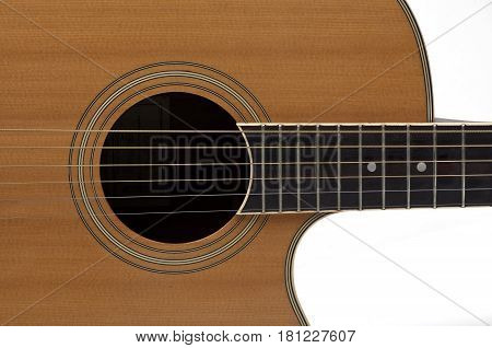 close up acoustic guitar strings and guitar neck