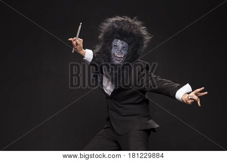 A Man In A Monkey Mask On A Black Background