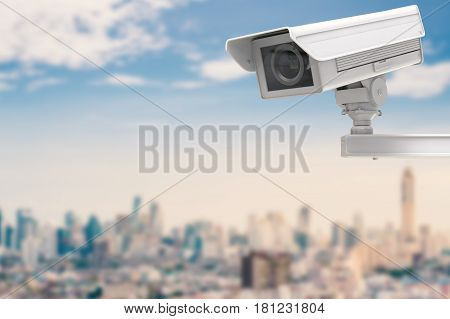Cctv Camera Or Security Camera On Cityscape Background