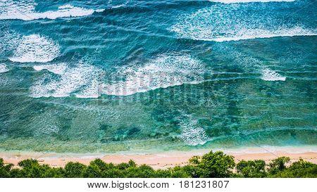 Top Aerial view of Nunggalan Beach near Uluwatu, Bali, Indonesia.